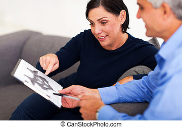 mature female patient looking at Rorschach inkblot with...