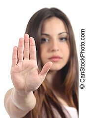 Woman making stop gesture with her hand isolated on a white...