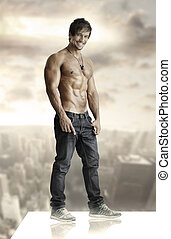 Young man on top of world - Concept winning portrait of a...