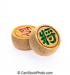 Chinese chess - Pair of wooden Chinese chess against white...