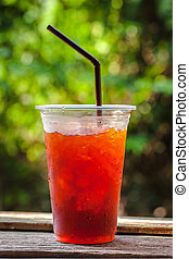 Cool drink - Red cool drink in plastic cup with water bubble...