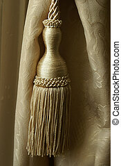 Curtain Tassel - A clsoeup shot of an elegant curtain...
