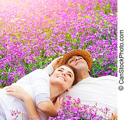 Happy lovers on lavender glade - Handsome man with...
