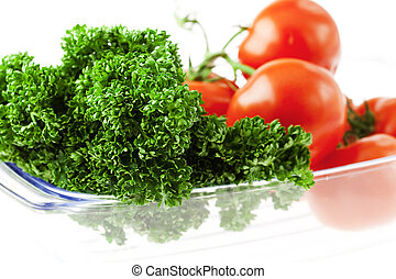 tomatoes and herbs in a glass