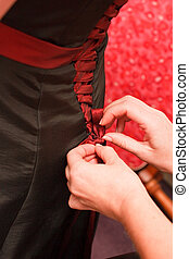 lacing up the dress - lacing up the maid of honours or...