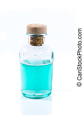 Glass bottle of turquoise blue liquid - Clear glass bottle...