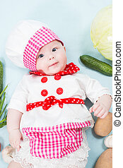 Baby girl  wearing a chef hat with vegetables  Use it for a child, healthy food concept