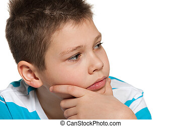 Thoughtful boy looking aside - A portrait of a thoughtful...