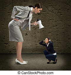 concept of aggression - Business woman yelling at a small...