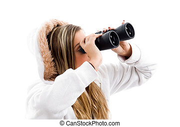 young woman eyeing something with binoculars
