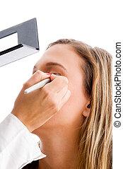 beautiful woman getting eye makeup
