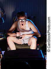 Gamer nerd playing video games on television - A excited...
