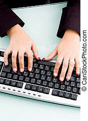 professional fingers working on keyboard with white...