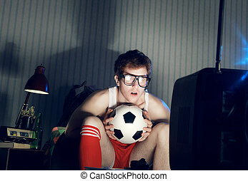 Soccer Fan Watching Television - Young man soccer fanatic...
