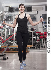 woman lifting weights - Smiling fitness woman lifting...