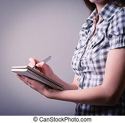 Girl writing in a notebook