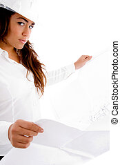 young female constructor searching blue prints with white...