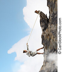 businesswoman climbing mountain - businesswoman climbing...