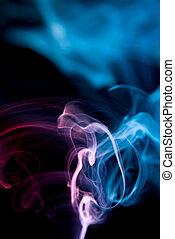 Coloured smoke isolated on black background.