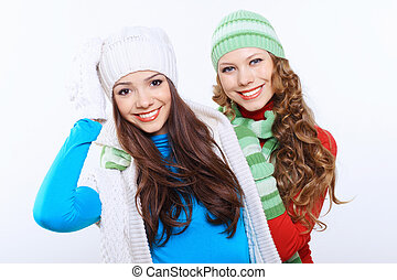Young woman wearing winter hat and warm scarf - Young pretty...