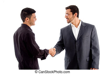businesspeople communicating and shaking hand against white...
