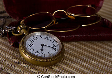 Pocket watch and glasses old detail macro vintage
