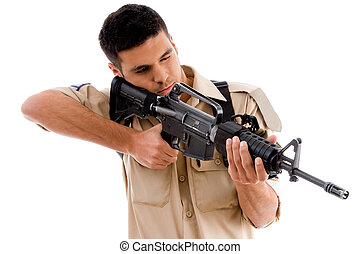 soldier pointing with gun on an isolated white background