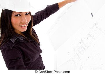 young female engineer searching opened blue prints - young...