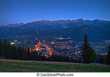 Night panorama of Zakopane against the Tatras, Poland.