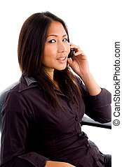 young asian service provider busy on cell phone against...