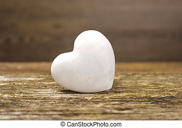 white heart of stone on wood