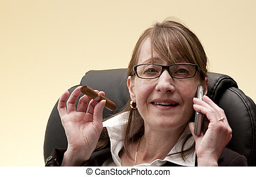 the business woman - a busy business woman talks on her cell...
