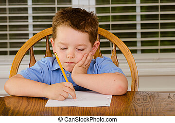 Thoughtful child doing his homework