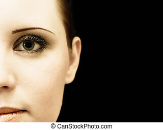 half woman face against the black background