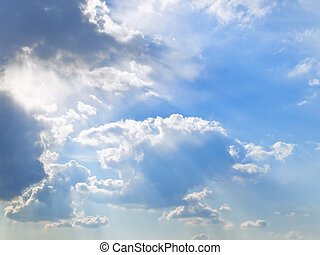 Sky and sun lights - The cloudy blue sky with sunbeam...