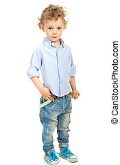Casual toddler boy with blond hair posing in modern jeans...