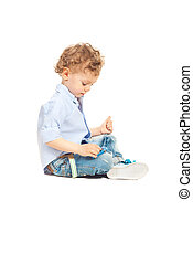 Toddler boy playing with car toy