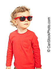 Modern kid boy with sunglasses looking away isolated on...