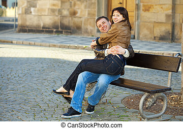 love couple sitting on the bench
