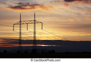 Electricity pylon on sunset - power energy