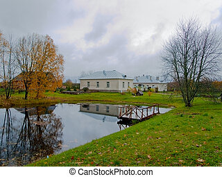 farmstead with green yard and pond