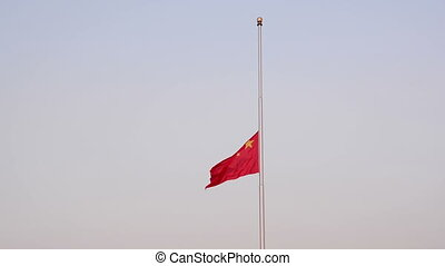 china national flag - The flag lowering ceremony in front of...