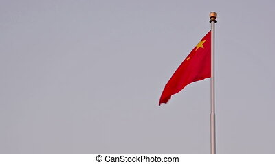 china flags - the chinese red flag flying against the sky