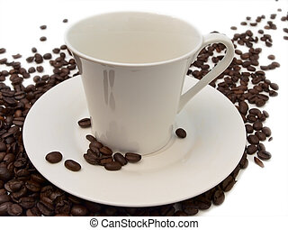 coffee beans and cup - white cup and some coffee beans near...