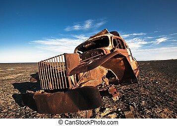 car on the shore - broken car
