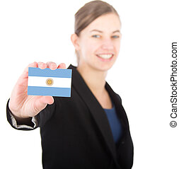 business woman holding a card with the Argentinian flag....