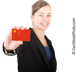 business woman holding a card with the Chinese flag