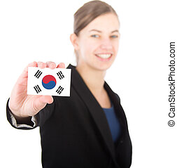 business woman holding a card with the South Korean flag