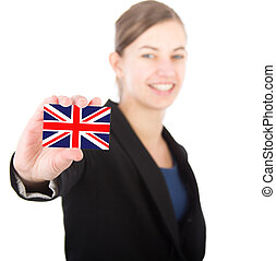 business woman holding a card with the English flag
