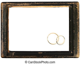 vintage wooden frame and wedding rings - vintage wooden...